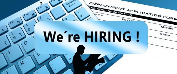 We're hiring silhouette; keyboard and application form in the background